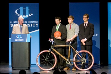 Bill Clinton presenting a signed basketball to GW students Chris Deschenez, John Torrey, and Matthew Wilkins for winning the CGIU Commitment Challenge. Photo by Marie McGrory of the GW Hatchet