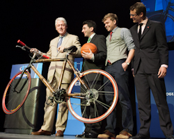 Bill Clinton congratulates Pedal Forward founders for winning the Clinton Global Initiative U. commitment challenge